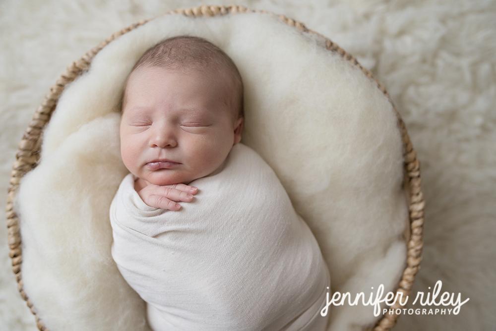 Frederick md newborn photographer baby basket jenniferrileyphotography newborn baby bed photography newborn baby photography newborn chin in hands pose