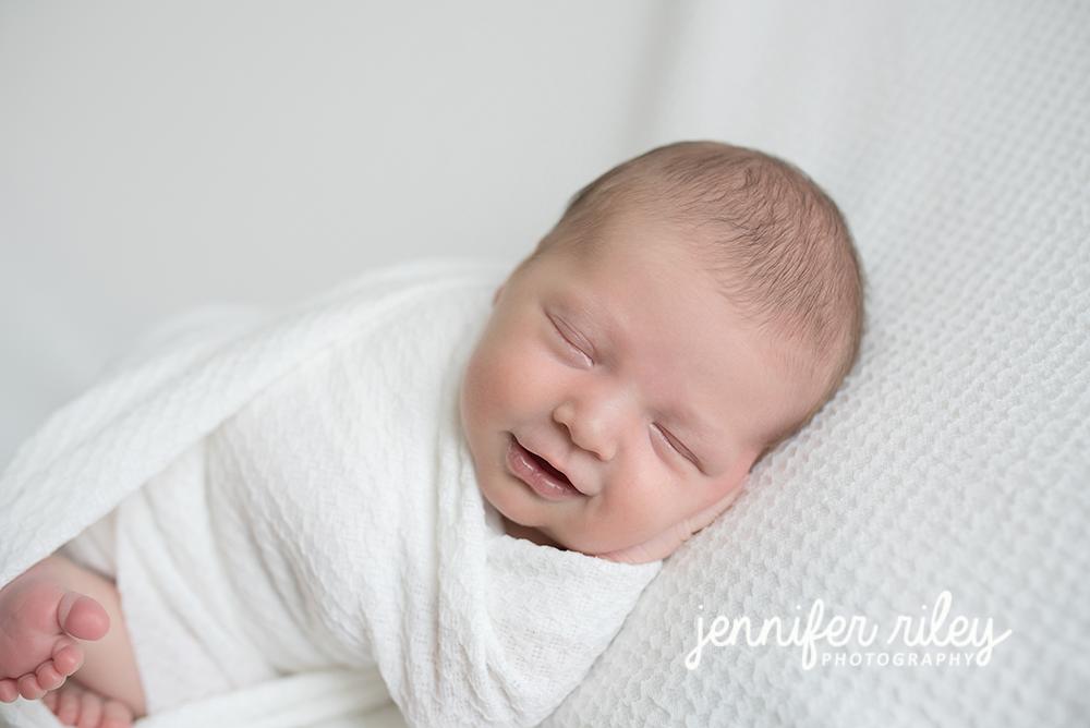 Jenniferrileyphotography newborn baby bed photography newborn baby photography newborn chin in hands pose newbornphotographerfrederickmd