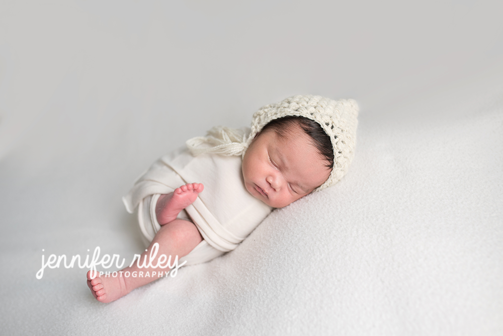 Newborn Baby In Whie Hat
